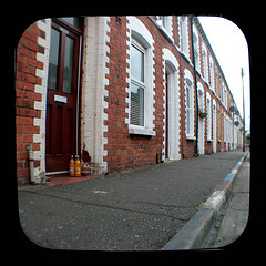 A Row of Terrace Houses with Doorsteps in need of Cleaning.