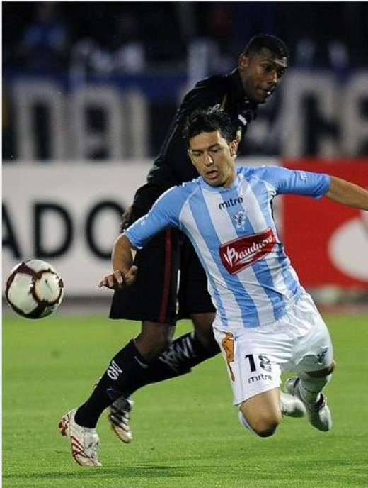 Dash to the finish. Uruguay's Alvaro Mello (front) fighting for ball possession against his opponent. Photo from AFP, FIFA.com