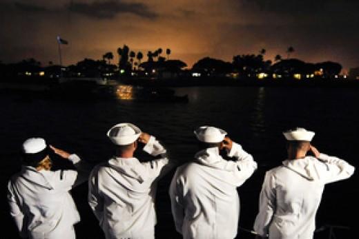 US Navy Sailors saluting the USS Utah Memorial in Honolulu Harbor