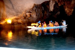A paddle-boat with tourists like us navigating the underground river