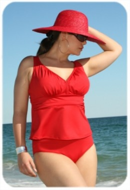 The hot new tankini of the season for a sophisticated and sexy look. The v-neck top with soft bra cup enhances your bust with a shirred band below the chest that adds a detail to the suit that slims the waist. The brief is a solid color.