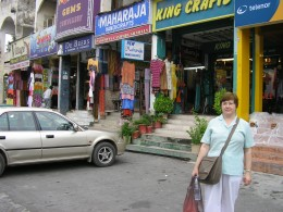 Outside the shop where I bought a water Pashmina shawl.  After being told I should have worn a shawl in the Faisal Mosque.