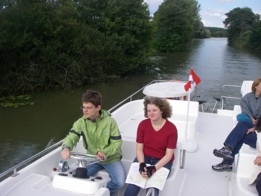 Christopher and Gisela driving our boat before our Austrian flag blew away.