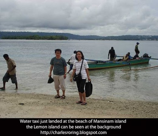 Asian tourists had just landed at the tropical beach of Mansinam island
