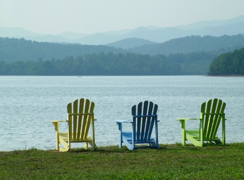 Adirondack chairs complete the relaxing feel of a lakeside retreat. (Photo courtesy sxc.hu)