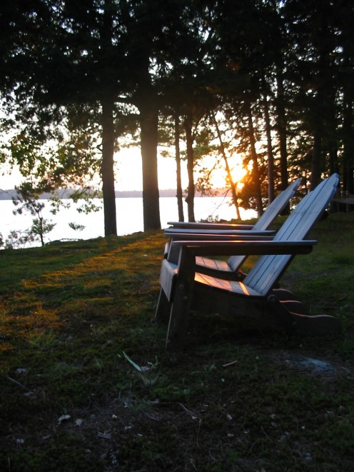 Whether lakeside, in the mountains, on the beach or in the backyard, the Adirondack chair exemplifies the relaxed feeling of being on vacation. (Photo courtesy sxc.hu)