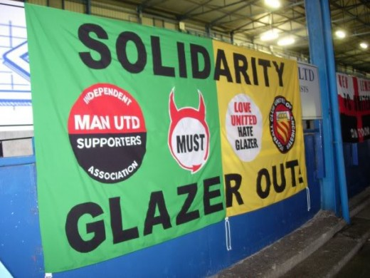 An anti glazer banner with phrases such as love united hate glazer.  From thebusbyway.com