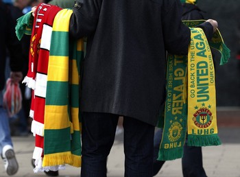 Man sells green and gold Glazer protest scarves