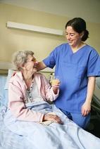 A Nurse Attending to a Senior Patient