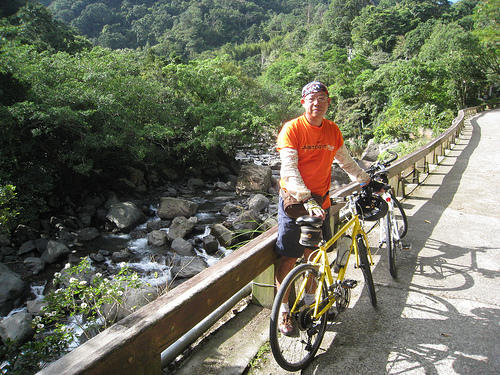 A man with a touring bicycle.