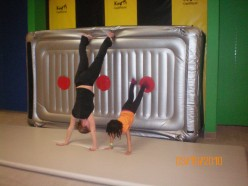 One of the trainers teaching my little one how to safely do a hand stand