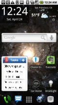 """HelixLauncher, running Galactic Core Live Wallpaper, note the 4 permanent """"dock"""" at the bottom. The """"keypad"""" pops up the app """"drawer""""."""