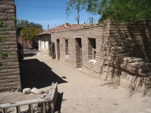 Reconstructed buildings along north side of wall.