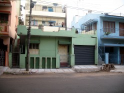 Around noon noon Kanaka went up on to her terrace to bring down dried Sandige and perhaps tested if the already broken parapet wall by a tree fall held by steel grill was strong fearing it would fall on some one in her street and hurt badly.While doi