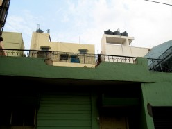 The broken unrepaired parapet wall over terrace from where our sweet lady of the street fell and died at a young age.