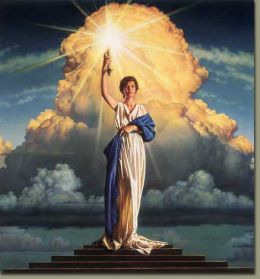 The Goddess Columbia, of Columbia motion pictures, standing atop a pyramid.