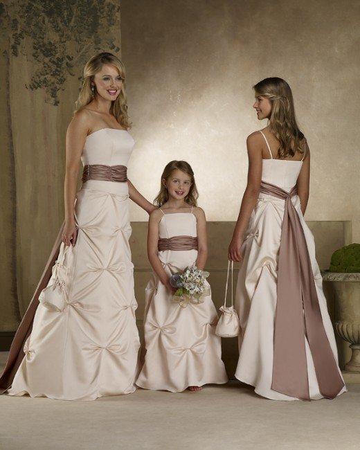 Bridesmaid Dresses: Forever Yours Bridesmaids Dresses #78101 Lamore satinStrapless A-line gown with ruched waistband and pick-ups on the skirt. Long tails highlight the back