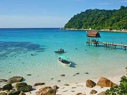 Enjoy swimming in the turquoise-blue sea at Perhentian
