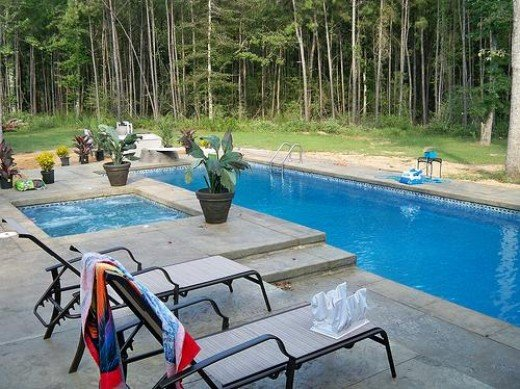 A fiberglass pool designed to the clients specification with a Royal Blue Sapphire Spa built in.