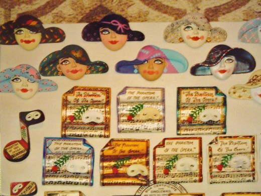 A variety of theatrical pins and ladies with hats