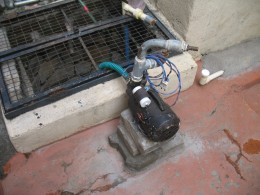 THE ELECTRIC MOTOR WITH PUMP TO PUMP OUT WATER FROM THE WELL.