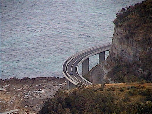 SEA CLIFF BRIDGE from an unusual angle atop of the ILLAWARRA ESCARPMENT. The bridge was built between Coalcliff and Clifton because the main road, Lawrence Hargrave Drive was in constant danger of being hit by rocks and large boulders from the cliffs