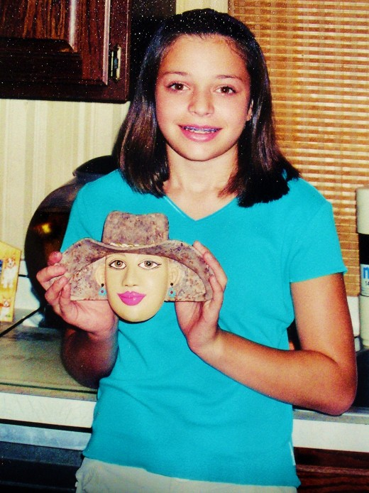 Danielle with a Peek-A-Boo hat wall mask she made.