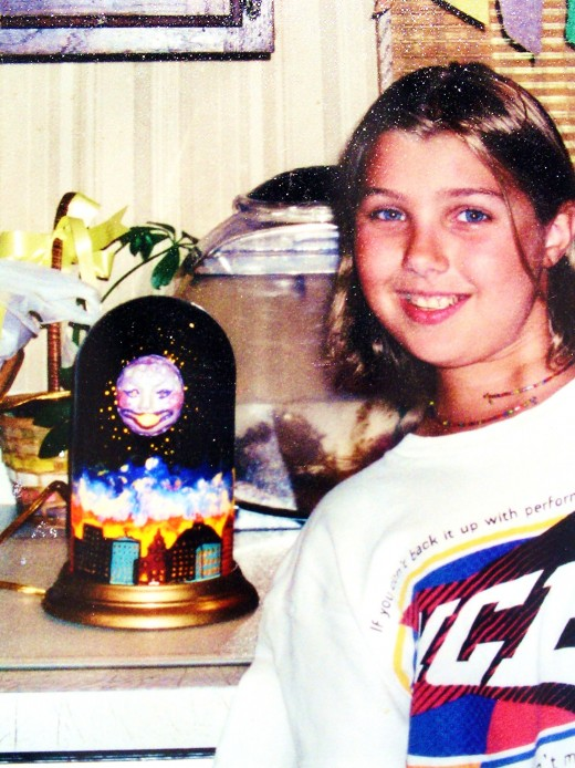 A student with a glass dome night light with moon sculpture attached