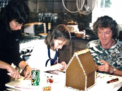 Sarah, her mom and I making a Large gingerbread house