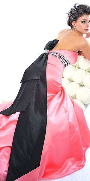 Prom Dress: Precious Formals Prom Dress Style P20631 empire strapless prom dress bead and gems empire band, vertically tiered bow on the back. Mermaid with front slit and sweep train. Zipper back closure. Satin Fabric
