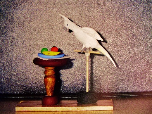 A ist graders parrot and fruit out of sculpey clay