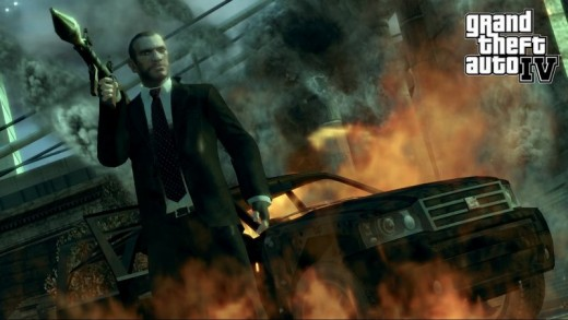Niko Bellic stands by a fiery car in GTA:IV, but I promise there are a lot of emotions to go with the explosions!  Credit to thegamreviews.com