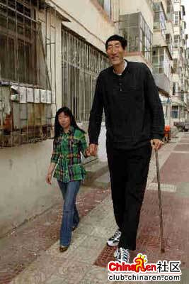 Newly-wed Bao Xishun, 7 feet and 8.95 inches tall holds wife Xia Shujuan's (5 feet, 8 inches tall) hand to manifest real feelings of love