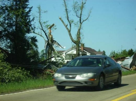 Debris surrounds a house