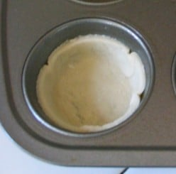 Lightly mold dough to bottom and sides of muffin cup.