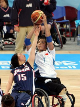 Wheelchair basketball being played at the Beijing Olypmics. From http://images.beijing2008.cn/20080120/Img214236010.jpg