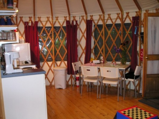 This looks comfy. The interior of a large yurt can give all the comforts of what we regard as our traditional style of home.
