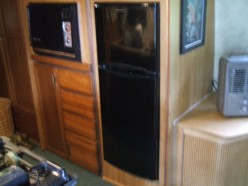 The absorption fridge in this Airstream Sovereign was replaced by a $200 110 volt AC model.