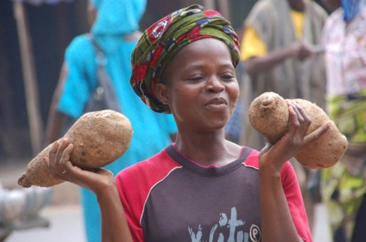 West African Girl with Yams