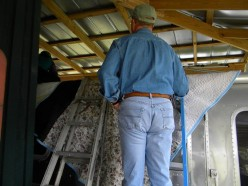 To inspect the roof of a classic used Airstream, use padding to protect the exterior