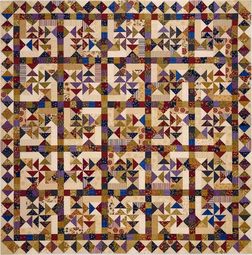 Whirligig, quilt designed by Carrie Nelson, pieced by Judy Adams, quilted by Diane Tricka.