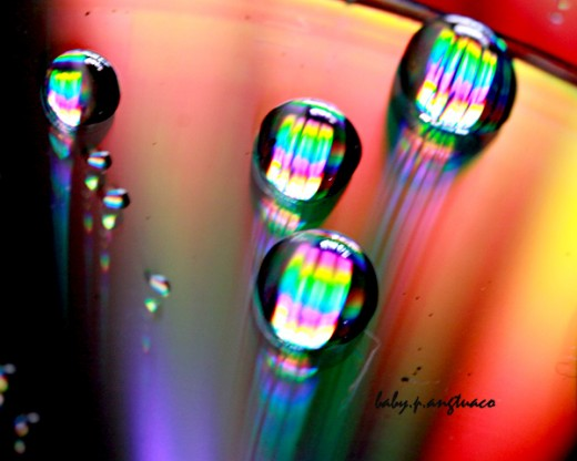 rainbow colors on water drops and cd