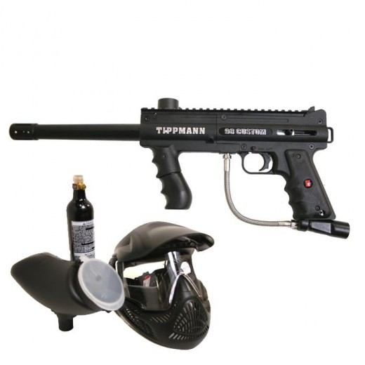 Tippman 98 Custom - the dominant airsoft rental today. Shown with a hopper and a gas tank. Paintball mask is included in most rentals