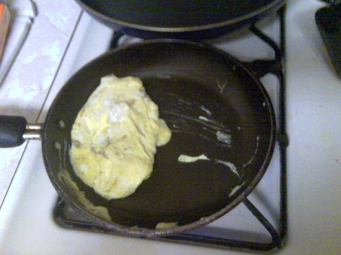 Just before it starts to become an omelet work it gently try to keep it in one piece!