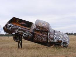 This is a 1964 EH Holden ute There was no plaque to identify the Artist of this Instillation, a great example of Indigenous Art.