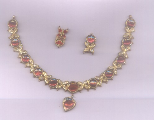Kundan Meena necklace set studded with ruby and diamond polki jadau