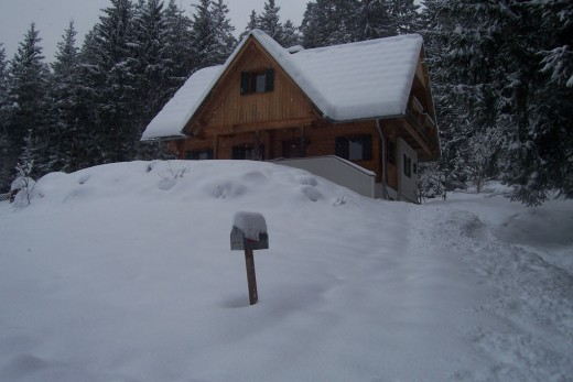 The Pack house covered in snow in winter