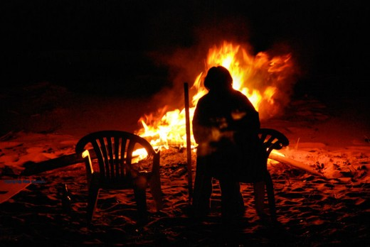 A beach bonfire on a calm night on Whitefish Bay, Paradise, Michigan.