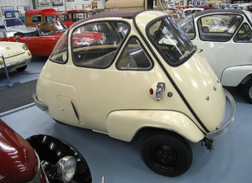 This strange little car is an Isetta. The front opens like a door to allow entry.