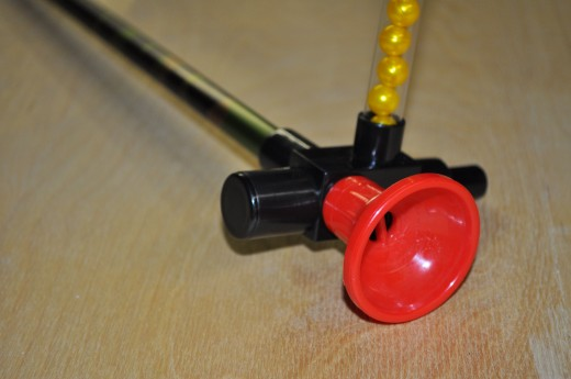 This is the blowgun paintball repeater, shown mounted on blowgun barrel with mouthpiece in place and magazine filled with paintballs.  We won't need the barrel or mouthpiece for our mod.